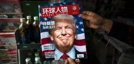 """TOPSHOT - A copy of the local Chinese magazine Global People with a cover story that translates to """"Why did Trump win"""" is seen with a front cover portrait of US president-elect Donald Trump at a news stand in Shanghai on November 14, 2016.   Chinese President Xi Jinping and US president-elect Donald Trump agreed November 14 to meet """"at an early date"""" to discuss the relationship between their two powers, Chinese state broadcaster CCTV said.  / AFP / JOHANNES EISELE        (Photo credit should read JOHANNES EISELE/AFP/Getty Images)"""