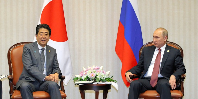 LIMA, PERU - NOVEMBER 19:  (CHINA OUT, SOUTH KOREA OUT) Japanese Prime Minister Shinzo Abe and Russian President Vladimir Putin talk during their meeting on the sidelines of the Asia-Pacific Economic Cooperation (APEC) summit on November 19, 2016 in Lima, Peru. Abe in Peru to participate in the summit meeting discussing on the Trans-Pacific Partnership (TPP).  (Photo by The Asahi Shimbun via Getty Images)