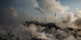"""INNER MONGOLIA, CHINA - NOVEMBER 03: Steam and smoke from waste coal and stone rises after being dumped next to an unauthorized steel factory on November 3, 2016 in Inner Mongolia, China. To meet China's targets to slash emissions of carbon dioxide, authorities are pushing to shut down privately owned steel, coal, and other high-polluting factories scattered across rural areas. In many cases, factory owners say they pay informal """"fines"""" to local inspectors and then re-open. The enforcement comes as the future of U.S. support for the 2015 Paris Agreement is in question, leaving China poised as an unlikely leader in the international effort against climate change. U.S. president-elect Donald Trump has sent mixed signals about whether he will withdraw the U.S. from commitments to curb greenhouse gases that, according to scientists, are causing the earth's temperature to rise. Trump once declared that the concept of global warming was """"created"""" by China in order to hurt U.S. manufacturing. China's leadership has stated that any change in U.S. climate policy will not affect its commitment to implement the climate action plan. While the world's biggest polluter, China is also a global leader in establishing renewable energy sources such as wind and solar power. (Photo by Kevin Frayer/Getty Images)"""