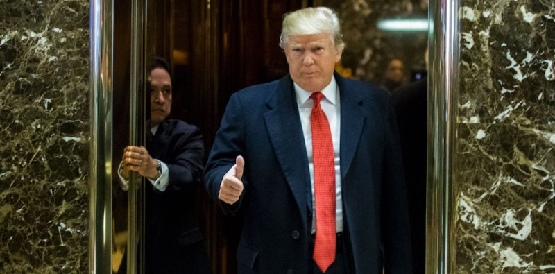 US President-elect Donald Trump gives a thumb up as he exits elevators to talk with the media at Trump Tower on December 6, 2016 in New York. / AFP / Eduardo Munoz Alvarez        (Photo credit should read EDUARDO MUNOZ ALVAREZ/AFP/Getty Images)