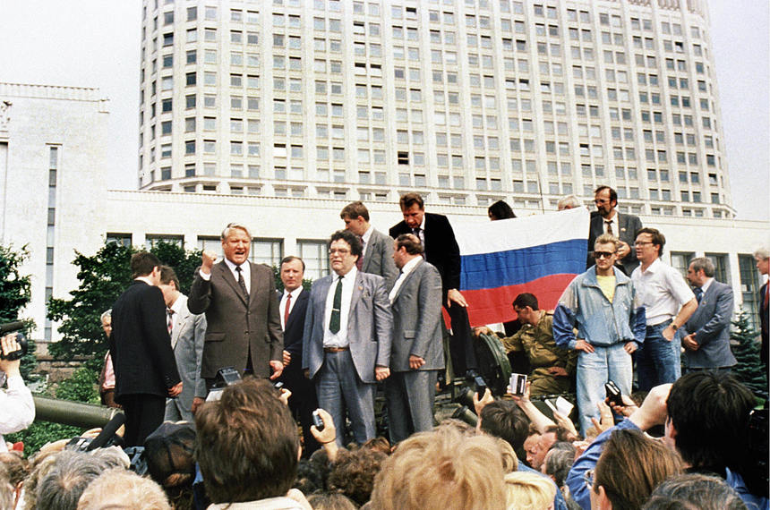 "Moscow, RUSSIAN FEDERATION: (FILES) A picture taken 19 August 1991 shows Russian President Boris Yeltsin (L) standing on top of an armoured vehicle parked in front of the Russian Federation building as supporters hold a Russian federation flag in Moscow. Russia's former president Boris Yeltsin died Monday, a Kremlin spokesman told AFP Monday. He was 76. ""Former president Boris Yeltsin died today,"" the spokesman said. AFP PHOTO FILES  (Photo credit should read DIANE-LU HOVASSE/AFP/Getty Images)"