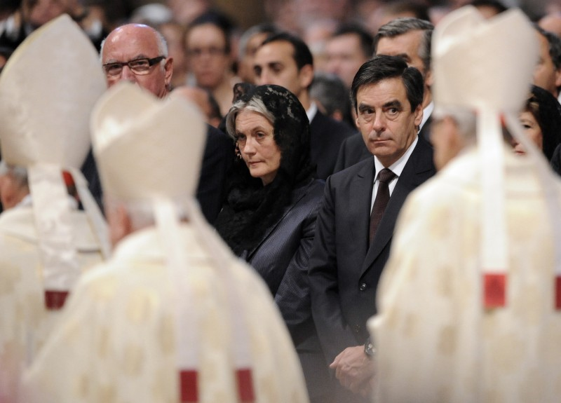 French prime minister Francois Fillon (C) and his wife Penelope wait for Pope Benedict XVI 's arrival during the canonisation ceremony of the blesseds, Ukrainian Zygmunt Szczesny Felinski , Spanish Francisco Coll y Guitart, Belgian Josef, Daamian de Veuster, Spanish Rafael Arnaiz Bar?n, French Marie de la Croix (Jeanne) Juganon In St. Peters's basilica at the Vatican on October 11, 2009. AFP PHOTO / ALBERTO PIZZOLI (Photo credit should read ALBERTO PIZZOLI/AFP/Getty Images)
