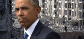 TOPSHOT - A member of the Syrian pro-government forces stands amid heavily damaged buildings in Aleppo's 1070 district on November 8, 2016, after troops seized it from rebel fighters. Syrian state media said government forces had advanced southwest of divided second city Aleppo, seizing the 1070 district from rebel forces. The Syrian Observatory for Human Rights monitor also reported the advance, saying it would allow government forces to protect areas already under their control on the southern outskirts of Aleppo.   / AFP / GEORGES OURFALIAN        (Photo credit should read GEORGES OURFALIAN/AFP/Getty Images)