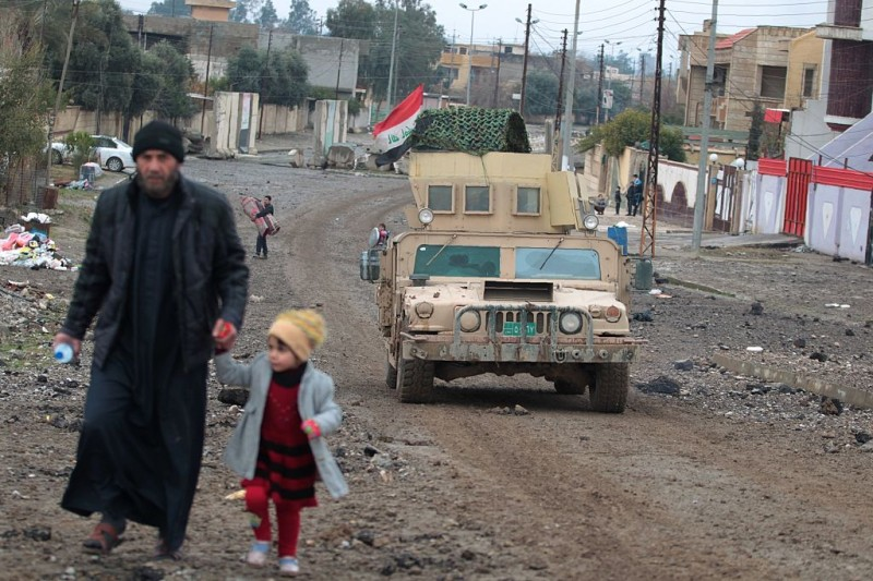 An Iraqi man and a girl fleeing the Islamic State (IS) group controlled Rashidiyah neighbourhood arrive to the Arabi neighbourhood north of Mosul on January 22, 2017 as a military operation against the jihadists continues. Iraqi forces retook two areas from the Islamic State group in Mosul, sealing their control of the east bank three months into an offensive to reclaim the city.   / AFP / AHMAD AL-RUBAYE        (Photo credit should read AHMAD AL-RUBAYE/AFP/Getty Images)