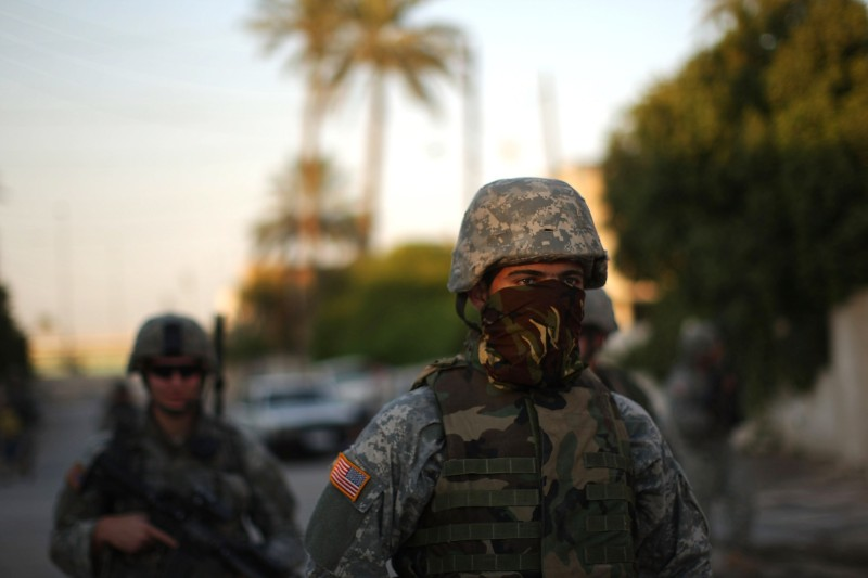 BAGHDAD, IRAQ - AUGUST 23:  An interpreter with the U.S. Army Bravo Company 82nd Airborne participates in a patrol August 23, 2007 in Baghdad, Iraq. There are increasing calls for the resignation of Iraqi Prime Minister Nouri al-Maliki due to his failure to quell walkouts by Sunni members of Parliament and his inability to bring about agreements on power sharing within the divided government.  (Photo by Spencer Platt/Getty Images)
