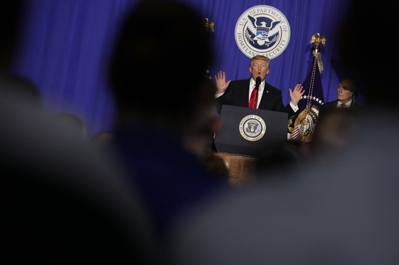 WASHINGTON, DC - JANUARY 25:  (AFP OUT) U.S. President Donald Trump delivers remarks during a visit to the Department of Homeland Security January 25, 2017 in Washington, DC. While at the department, Trump signed two executive orders related to internal security and to begin the process of building a wall along the U.S.-Mexico border.  (Photo by Chip Somodevilla/Getty Images)