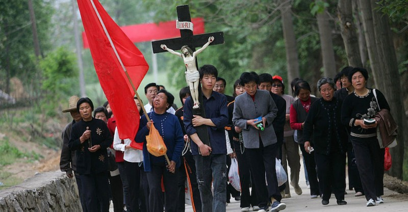 "MEIXIAN COUNTY, CHINA - MAY 2: (CHINA OUT) Catholics walk to the simulated crucified site of Jesus at Cross Hill at Paowo Village on May 2, 2007 in Meixian County of Shaanxi Province, China. Cross Hill is a Cross Hill is a Catholic holy place first built by missionary Liu Jialu as a simulation of Calvary. Liu was approved by the Pope Pius VI to name the place ""Cross Hill"". In 1777, Bishop Nania of Shaanxi Province appointed May 3 and September 14 as the Holy Day for all people who came to worship, according to local media. (Photo by China Photos/Getty Images)"