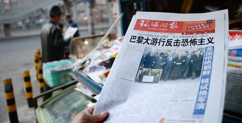 "Chinese newspaper front pages show their coverage of marches held in response to the recent Islamist attacks that killed 17 people, most at the Paris offices of satirical magazine Charlie Hebdo, at a newsstand in Beijing on January 12, 2015. About a hundred thousand people rallied worldwide in solidarity with France on January 11, with marchers across Europe and the Middle East chanting ""Je suis Charlie"" and holding pens in the air. AFP PHOTO / WANG ZHAO        (Photo credit should read WANG ZHAO/AFP/Getty Images)"
