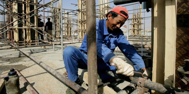 A Chinese worker fixes pipes at a construction site in the capital Khartoum on February 2, 2012.  Africa, where China has emerged as a major funder of infrastructure projects, is growing particularly attractive for migrant workers seeking to earn good money, but the work does not go without its share of risks, as was illustrated last week by the abduction of the road-builders in Sudan and the technicians and engineers working for a military-owned cement factory in Egypt. AFP PHOTO/ASHRAF SHAZLY (Photo credit should read ASHRAF SHAZLY/AFP/Getty Images)