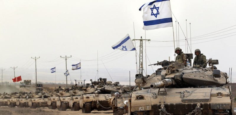 Israeli Merkava tanks drive near the border between Israel and the Gaza Strip as they return from the Hamas-controlled Palestinian coastal enclave on August 5, 2014, after Israel announced that all of its troops had withdrawn from the Gaza Strip. Israel completed the withdrawal of all troops from Gaza as a 72-hour humanitarian truce went into effect following intense global pressure to end the bloody conflict. AFP PHOTO / THOMAS COEX        (Photo credit should read THOMAS COEX/AFP/Getty Images)