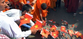 Cambodian protesters burn Vietnamese flags during a protest in front of the Vietnamese embassy in Phnom Penh on October 8, 2014. Cambodian protesters demanded Vietnam to recognise that Kampuchea Krom, which is now a part of Vietnam, is Cambodia's former territory. AFP PHOTO/ TANG CHHIN SOTHY        (Photo credit should read TANG CHHIN SOTHY/AFP/Getty Images)