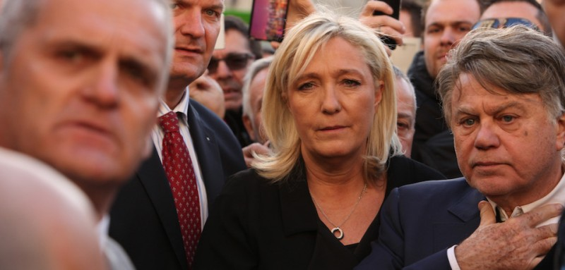 "BEAUCAIRE, FRANCE - JANUARY 11:  French Front National party president Marine Le Pen takes part in a Unity rally ""Marche Republicaine"" on January 11, 2015 in Beaucaire, France. The French far-right National Front (FN) held their own rally after being excluded from the Paris unity rally. An estimated one million people have converged in central Paris for the Unity March joining in solidarity with the 17 victims of this week's terrorist attacks in the country. French President Francois Hollande led the march and was joined by world leaders in a sign of unity. The terrorist atrocities started on Wednesday with the attack on the French satirical magazine Charlie Hebdo, killing 12, and ended on Friday with sieges at a printing company in Dammartin en Goele and a Kosher supermarket in Paris with four hostages and three suspects being killed. A fourth suspect, Hayat Boumeddiene, 26, escaped and is wanted in connection with the murder of a policewoman.  (Photo by Patrick Aventurier/Getty Images)"