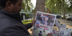 A Pakistani resident reads a newspaper with coverage of Donald Trump's victory in the US presidential election, in Islamabad on November 10, 2016. / AFP / AAMIR QURESHI        (Photo credit should read AAMIR QURESHI/AFP/Getty Images)