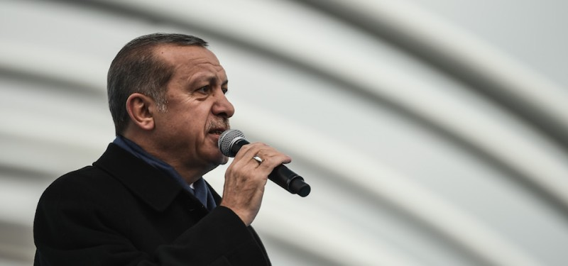 "Turkish President Recep Tayyip Erdogan gestures as he delivers a speech on December 20, 2016 in Istanbul, during the opening cerenomy of the Avrasya (Eurasia) Tunnel, the first ever road tunnel underneath the Bosphorus Strait in Istanbul from Europe to Asia and the latest project in the Erdogan's plan of transforming Turkey's infrastructure. Turkey in October 2013 opened the Marmaray rail tunnel underneath the iconic waterway, the first link beneath the waters that divide Europe and Asia. But the new Avrasya (Eurasia) Tunnel is the first tunnel for cars underneath the Bosphorus and aims to relieve congestion in the traffic-clogged Turkish megacity. Other schemes, which Erdogan boasts are his ""crazy projects"", include a gigantic third airport for Istanbul, the first ever bridge across the Dardanelles straits and even a Suez-style shipping canal for Istanbul. / AFP / OZAN KOSE        (Photo credit should read OZAN KOSE/AFP/Getty Images)"