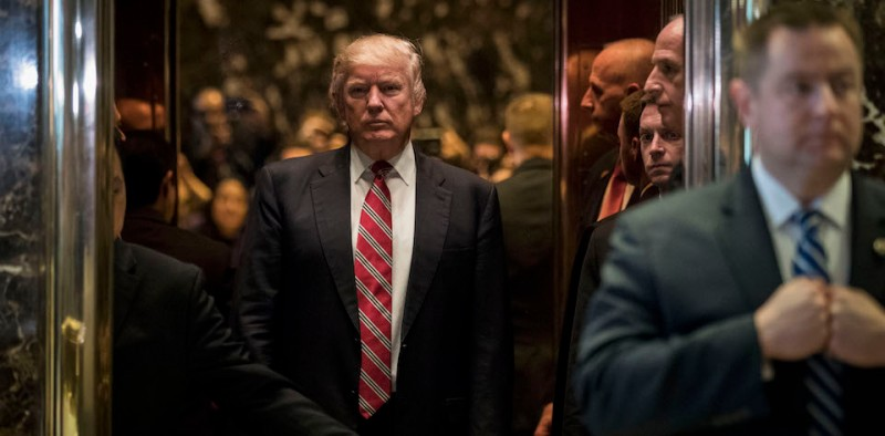 NEW YORK, NY - JANUARY 16: President-elect Donald Trump heads back into the elevator after shaking hands with Martin Luther King III after their meeting at Trump Tower, January 16, 2017 in New York City. Trump will be inaugurated as the next U.S. President this coming Friday. (Photo by Drew Angerer/Getty Images)