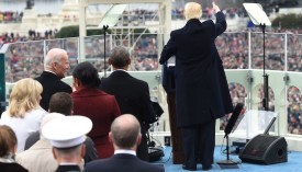 US President Donald Trump acknowledges the crowd during the Presidential Inauguration at the US Capitol in Washington, DC, on January 20, 2017. / AFP / POOL / SAUL LOEB        (Photo credit should read SAUL LOEB/AFP/Getty Images)