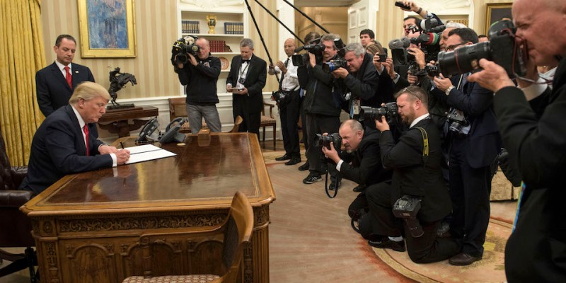 WASHINGTON, DC - JANUARY 20: President Donald Trump signs his first executive order as president, ordering federal agencies to ease the burden of President Barack Obama's Affordable Care Act January 20, 2017 in Washington, DC.  (Photo by Kevin Dietsch - Pool/Getty Images)