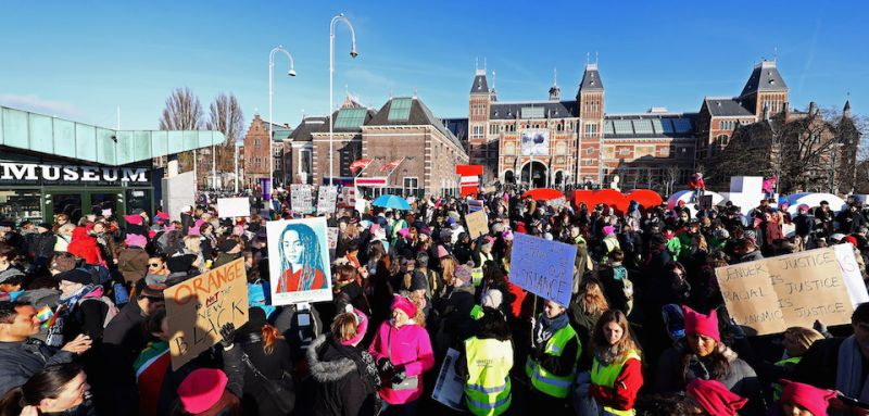 AMSTERDAM, NETHERLANDS - JANUARY 21:  Demonstrators make their way from the iamsterdam statue in front of the Rijksmuseum towards US Consulate during the Women's March held at Museumplein on January 21, 2017 in Amsterdam, Netherlands.  The Women's March originated in Washington DC but soon spread to be a global march calling on all concerned citizens to stand up for equality, diversity and inclusion and for women's rights to be recognised around the world as human rights. Global marches are now being held, on the same day, across seven continents.  (Photo by Dean Mouhtaropoulos/Getty Images)