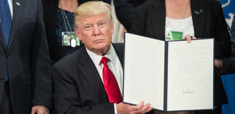 U.S. President Donald Trump signs an executive order to start the Mexico border wall project at the Department of Homeland Security facility in Washington, D.C., on January 25, 2017. (Nicholas Kamm/AFP/Getty Images)