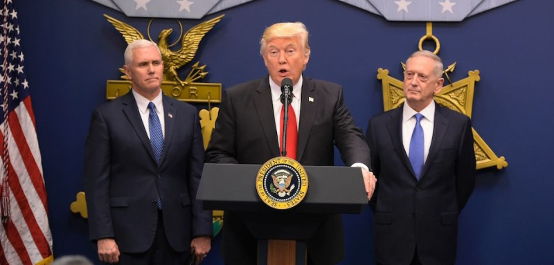 US President Donald Trump speaks the ceremonial swearing-in of James Mattis (R) as secretary of defense on January 27, 2017, at the Pentagon in Washington, DC. The oath was administered by US Vice President Mike Pence (L) / AFP / MANDEL NGAN        (Photo credit should read MANDEL NGAN/AFP/Getty Images)