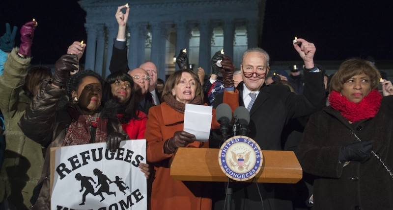 Senate Minority Leader Chuck Schumer (2nd R), Democrat of New York, US House Democratic Leader Nancy Pelosi (C), speak alongside other members of Congress as demonstrators protest against US President Donald Trump and his administration's ban of travelers from 7 countries by Executive Order, during a rally outside the US Supreme Court in Washington, DC, on January 30, 2017. Trump's executive order suspended the arrival of all refugees for at least 120 days, Syrian refugees indefinitely -- and bars citizens from Iran, Iraq, Libya, Somalia, Sudan, Syria and Yemen for 90 days.  Protests are taking place at airports across the country in opposition to the ban. / AFP / SAUL LOEB        (Photo credit should read SAUL LOEB/AFP/Getty Images)