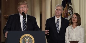 Judge Neil Gorsuch (C) and his wife Marie Louise look on, after US President Donald Trump nominated him for the Supreme Court, at the White House in Washington, DC, on January 31, 2017. Trump named Judge Neil Gorsuch as his Supreme Court nominee. / AFP / Brendan SMIALOWSKI        (Photo credit should read BRENDAN SMIALOWSKI/AFP/Getty Images)