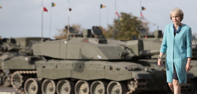 SALISBURY, ENGLAND - SEPTEMBER 29:  Prime Minister Theresa May passes tanks as she visits 1st Battalion The Mercian Regiment (Cheshire, Worcesters and Foresters, and Staffords) at their barracks at Bulford Camp on September 29, 2016 near Salisbury, England.  The Prime Minister visited the military base in the Salisbury Plain area to meet with soldiers, see the equipment they work with and to also meet with some their families.  (Photo by Matt Cardy - WPA Pool/Getty Images)