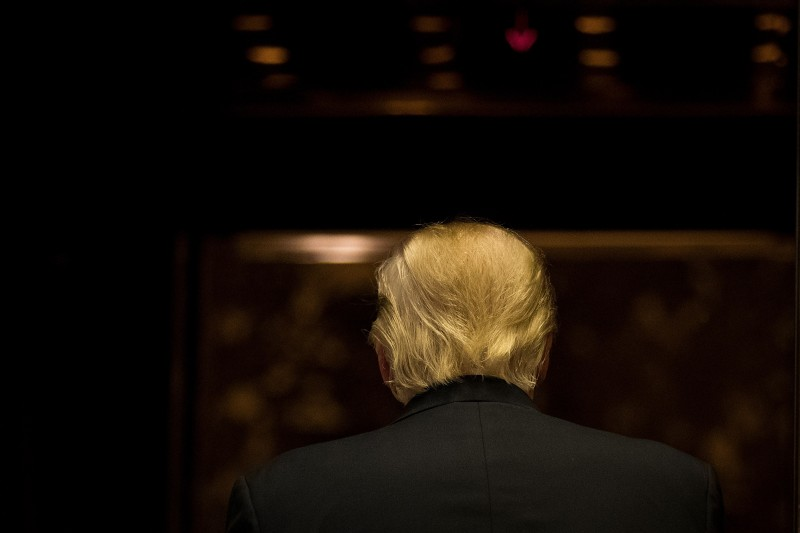 NEW YORK, NY - JANUARY 13: President-elect Donald Trump gets into the elevator after speaking to reporters after his meeting with television personality Steve Harvey at Trump Tower, January 13, 2017 in New York City. President-elect Trump continues to hold meetings at Trump Tower in New York. (Photo by Drew Angerer/Getty Images)