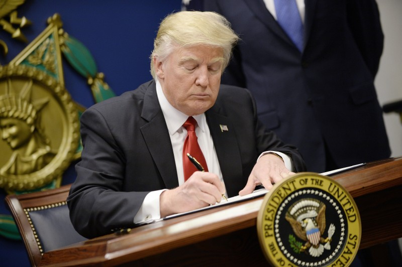 "ARLINGTON, VA - JANUARY 27: U.S. President Donald Trump signs executive orders in the Hall of Heroes at the Department of Defense on January 27, 2017 in Arlington, Virginia. Trump signed two orders calling for the ""great rebuilding"" of the nation's military and the ""extreme vetting"" of visa seekers from terror-plagued countries. (Photo by Olivier Douliery-Pool/Getty Images)"