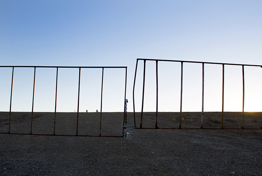 TOPSHOT - A worn gate marks the boundary near the US/Mexico border in Presidio, Texas, on February 20, 2017. ATTENTION EDITORS: This image is part of an ongoing AFP photo project documenting the life on the two sides of the US/Mexico border simultaneously by two photographers traveling for ten days from California to Texas on the US side and from Baja California to Tamaulipas on the Mexican side between February 13 and 22, 2017. You can find all the images with the keyword : BORDERPROJECT2017 on our wire and on www.afpforum.com / AFP / JIM WATSON        (Photo credit should read JIM WATSON/AFP/Getty Images)