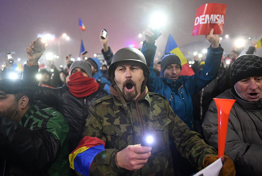 TOPSHOT - People protest against the government in Bucharest on February 6, 2017. Romania's government formally repealed Sunday contentious corruption legislation that has sparked the biggest protests since the fall of dictator Nicolae Ceausescu in 1989, ministerial sources said. / AFP / Daniel MIHAILESCU        (Photo credit should read DANIEL MIHAILESCU/AFP/Getty Images)