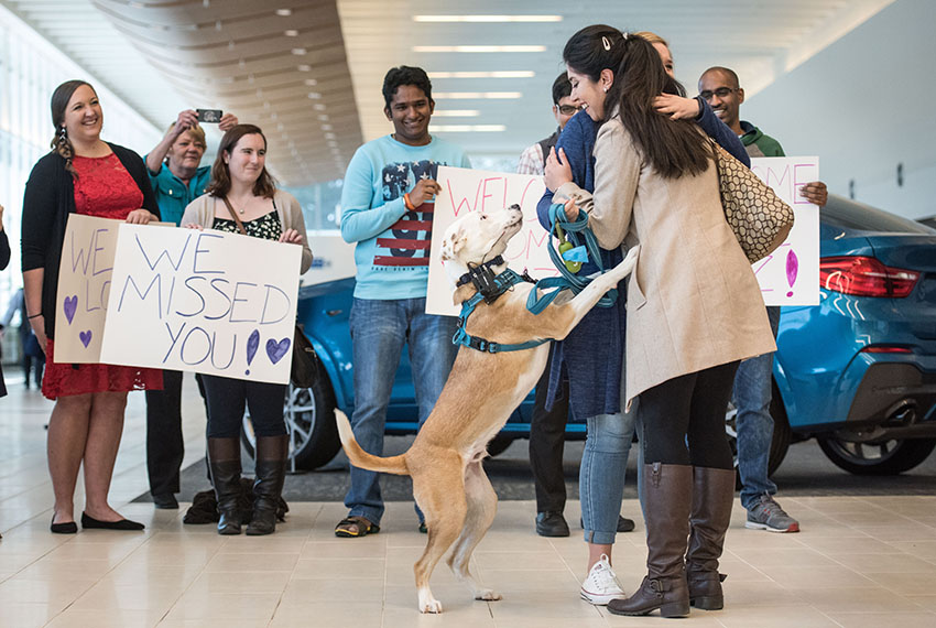 GREENVILLE, SC - FEBRUARY 6, 2017:  Iranian engineer Nazanin Zinouri, with her dog Dexter, gets a hug from Emma Porter after arriving at the Greenville Spartanburg Airport February 6, 2017 in Greenville, South Carolina. Zinouri, a Clemson graduate, works for a technology firm in Greenville, South Carolina and has lived in the United States for the last seven years. While attempting to return to South Carolina after a recent trip visiting family in Iran, she had been taken off her flight in Dubai as a result of the recent travel and immigration ban ordered by President Donald Trump. (Photo by Sean Rayford/Getty Images)