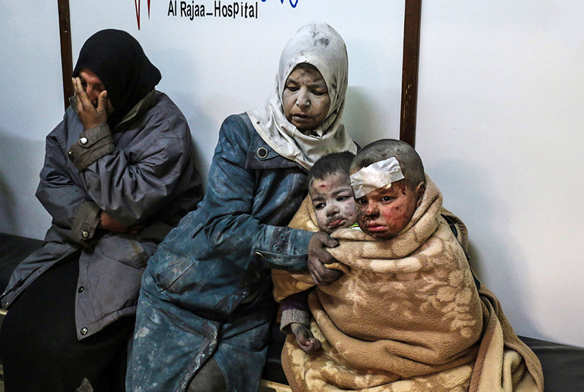 TOPSHOT - A Syrian woman sits with injured children at a hospital following a reported strike by government forces in the rebel-held distric of Barzah, on the north-eastern outskirts of the capital Damascus, on February 20, 2017.    / AFP / Saria ABU ZAID        (Photo credit should read SARIA ABU ZAID/AFP/Getty Images)