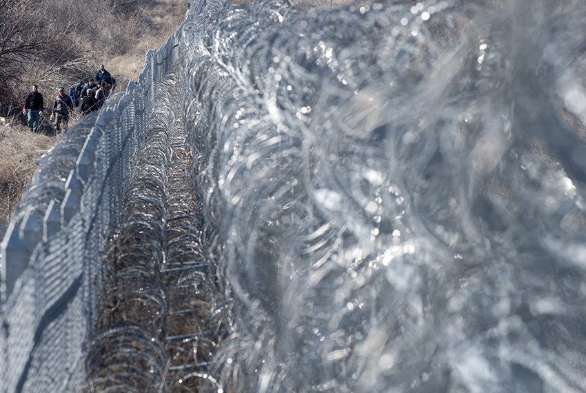 Workers fix the barbed wire wall fence on the Bulgaria-Turkey border near the town of Lesovo on February 21, 2017.      / AFP / NIKOLAY DOYCHINOV        (Photo credit should read NIKOLAY DOYCHINOV/AFP/Getty Images)
