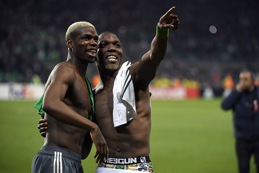 TOPSHOT - Manchester United's French midfielder Paul Pogba (L) and his brother Saint-Etienne's Guinean defender Florentin Pogba (R) greet their family in the tribune at the end of the UEFA Europa League football match between AS Saint-Etienne and Manchester United on February 22, 2017, at the Geoffroy Guichard stadium in Saint-Etienne, central France. / AFP / PHILIPPE DESMAZES        (Photo credit should read PHILIPPE DESMAZES/AFP/Getty Images)