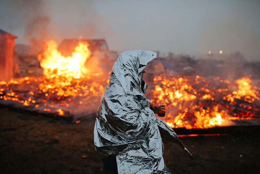 CANNON BALL, ND - FEBRUARY 22:  Campers set structures on fire in preparation of the Army Corp's 2pm deadline to leave the Oceti Sakowin protest camp on February 22, 2017 in Cannon Ball, North Dakota. Activists and protesters have occupied the Standing Rock Sioux reservation for months in opposition to the completion of the Dakota Access Pipeline. (Photo by Stephen Yang/Getty Images)
