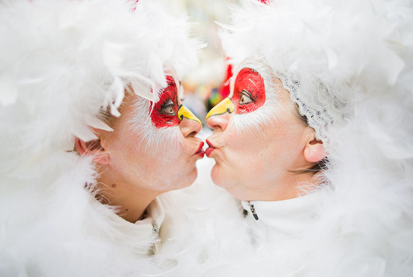 TOPSHOT - Two carnival revellers pose as they celebrate the start of the hot season on Women's Carnival, February 23, 2017, in Cologne, western Germany. / AFP / dpa / Rolf Vennenbernd / Germany OUT        (Photo credit should read ROLF VENNENBERND/AFP/Getty Images)