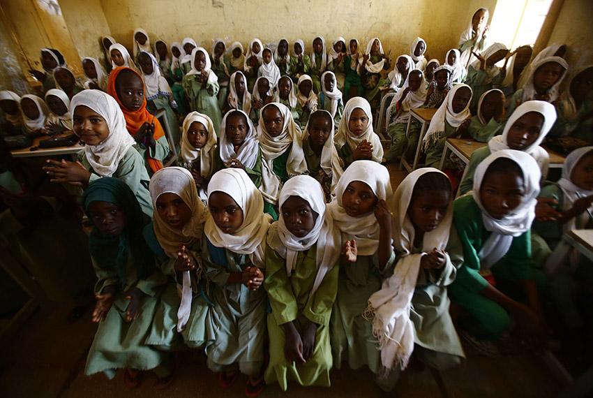 TOPSHOT - Sudanese girls sit in a classroom at the El-Riyadh camp for internally displaced persons (IDP) in Geneina, the capital of the state of Sudan's West Darfur, on February 8, 2017. / AFP / ASHRAF SHAZLY        (Photo credit should read ASHRAF SHAZLY/AFP/Getty Images)