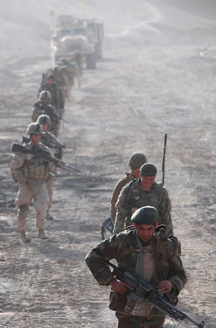 SANGIN, Helmand province, Islamic Republic of Afghanistan – Afghan National Army soldiers and Marines with 3rd Battalion, 5th Marine Regiment, patrol down route 611 during a clearing operation, known as outlaw wrath, in the Sangin District, Dec. 4, 2010. Marines with 1st Combat Engineer Battalion, 1st Marine Division (Forward), partnered with companies India and Kilo of 3/5 to clear the route of improvised explosive devices. The Companies provided security for Marines on the road by conducting foot patrols in the surrounding area. (U.S. Marine Corps photo by Cpl. John M. McCall)