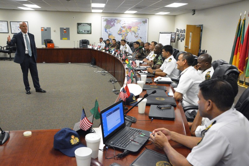 """150813-N-XX139-005  STENNIS SPACE CENTER, Miss. (Aug. 18, 2015) Retired Vice Adm. Robert Harward shares operational counter-terrorism experiences with 15 officers attending Naval Small Craft Instruction and Technical Training School's (NAVSCIATTS) Strategic Level Small Craft Combating Terrorism Course. During this course, the officers receive training on the strategic theory of standing-up, manning, training, equipping, resourcing, employing and sustaining a """"Combating Terrorism"""" unit. NAVSCIATTS is a Department of the Navy schoolhouse operating under the U.S. Special Operations Command, and trains and educates foreign security forces and other international students on small craft strategy, operations, communications, weapons, maintenance and instructor development. (U.S. Navy photo by Glenn Sircy/Released)"""