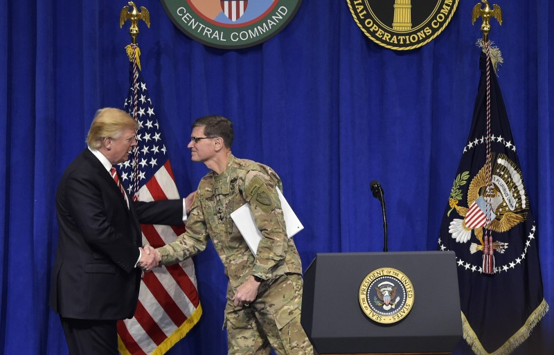 US President Donald Trump (L) shakes hands with CENTCOM Commander Joseph Votel (R) as he arrives on stage to speak following a visit to the US Central Command and Special Operations Command at MacDill Air Force Base on February 6, 2017 in Tampa, Florida. President Donald Trump on Monday paid his first visit to US Central Command, meeting officers who will form the tip of the spear in implementing his new strategy to defeat the Islamic State group. / AFP / MANDEL NGAN        (Photo credit should read MANDEL NGAN/AFP/Getty Images)