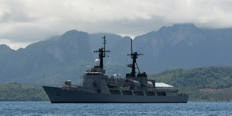 TO GO WITH Philippines-China-military-US-maritime-diplomacy,FOCUS by Cecil Morella This photo taken on June 7, 2014 shows the Philippine Navy frigate BRP Ramon Alacraz anchored at the mouth of the South China Sea in Ulugan Bay off Puerto Princesa on Palawan island. Ulugan Bay, with a coastline partly concealed by thick mangrove forests, is at the centre of the Philippine military's efforts to shore up the defence of contested South China Sea islands and waters.     AFP PHOTO / TED ALJIBE        (Photo credit should read TED ALJIBE/AFP/Getty Images)