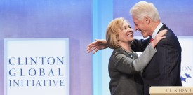 NEW YORK, NY - SEPTEMBER 22:  Former US Secretary of State Hillary Clinton and husband, Former U.S. President Bill Clinton embrace during the Opening Plenary Session: Reimagining Impact for the Clinton Global Initiative on September 22, 2014 at the Sheraton New York Hotel & Towers in New York City.  (Photo by Michael Loccisano/Getty Images)