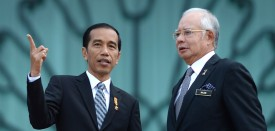Indonesia's President Joko Widodo (L) and Malaysian Prime Minister Najib Razak (R) talk to each other prior to their meeting at the prime minister's office in Putrajaya, outside Kuala Lumpur on February 6, 2015. Widodo arrived in Malaysia on February 5 for his first bilateral trip abroad, with the two sides hoping to shore up an important Southeast Asian relationship frequently strained by diplomatic spats. AFP PHOTO / MOHD RASFAN        (Photo credit should read MOHD RASFAN/AFP/Getty Images)