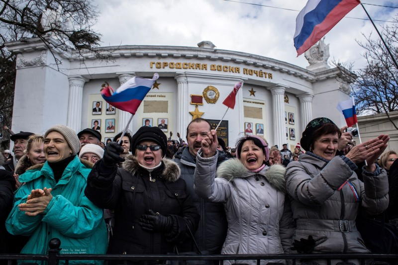 SEVASTOPOL, CRIMEA - MARCH 18:  People celebrate the first anniversary of the signing of the decree on the annexation of the Crimea by the Russian Federation, on March 18, 2015 in Sevastopol, Crimea. Crimea, an internationally recognised Ukrainian territory with special status, was annexed by the Russian Federation on March 18, 2014. The annexation, which has been widely condemned, took place in the aftermath of the Ukranian revolution. (Photo by Alexander Aksakov/Getty Images)