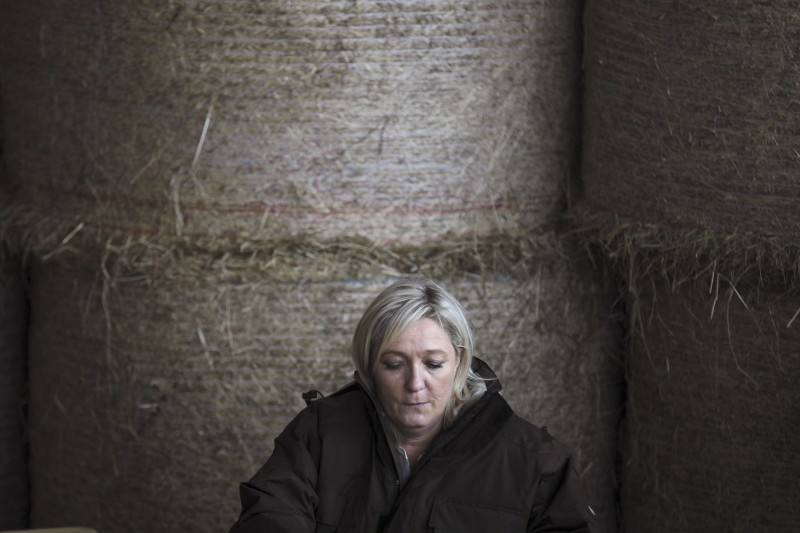 The leader of the French far-right National Front  (FN) party Marine Le Pen visits on March 20, 2015 a farm in the northwestern French town of Juilley ahead of the ahead of the March 22 and 29 departemental local elections.               AFP PHOTO/CHARLY TRIBALLEAU.        (Photo credit should read CHARLY TRIBALLEAU/AFP/Getty Images)