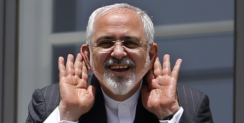 """Iranian Foreign Minister Mohammad Javad Zarif gestures as he talks to journalist from a balcony of the Palais Coburg hotel where the Iran nuclear talks are being held in Vienna on July 10, 2015. Iran accused major powers on Friday of backtracking on previous pledges and throwing up new """"red lines"""" at nuclear talks, after the deadline to reach an agreement in time to receive expedited scrutiny from the U.S. Congress expired with no deal.   AFP PHOTO / POOL / CARLOS BARRIA        (Photo credit should read CARLOS BARRIA/AFP/Getty Images)"""