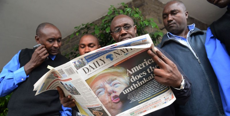 "People read a Kenyan daily newspaper with the front page showing newly elected US President Donald Trump in Nairobi on November 10, 2016.   Donald Trump's extraordinary US election victory sent shockwaves across the world on November 9, 2016, as opponents braced for a ""dangerous"" leader in the White House while fellow populists hailed a ballot-box revolution by ordinary people. America's allies put a diplomatically brave face on the outcome of the deeply divisive presidential race, which has implications for everything from trade to human rights, climate change to global conflicts.  / AFP / SIMON MAINA        (Photo credit should read SIMON MAINA/AFP/Getty Images)"