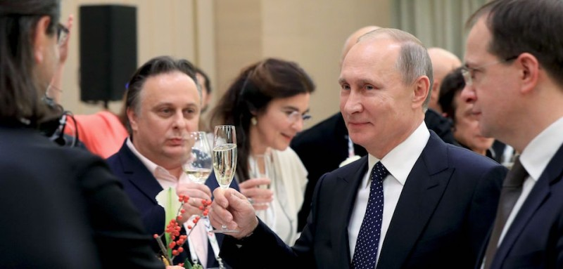 Russian President Vladimir Putin (R) holds a glass of champagne during a ceremony at the Mariinsky Theatre, as part of his visit to Saint Petersburg on December 2, 2016.  / AFP / SPUTNIK / Mikhail KLIMENTIEV        (Photo credit should read MIKHAIL KLIMENTIEV/AFP/Getty Images)