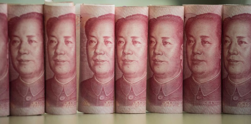 This photo illustration taken on January 6, 2017 shows Chinese 100 yuan notes in Beijing  China just raised the exchange rate for the yuan against the US dollar by 0.92 percent from the previous day, the biggest one-day increase in more than 11 years. / AFP / FRED DUFOUR        (Photo credit should read FRED DUFOUR/AFP/Getty Images)